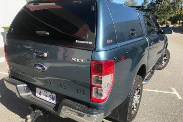 ford-ranger-fiberglass-solid-side-canopy-blue-rear